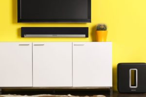 audio/ video services provider tv and sonos soundbar mounting on yellow wall