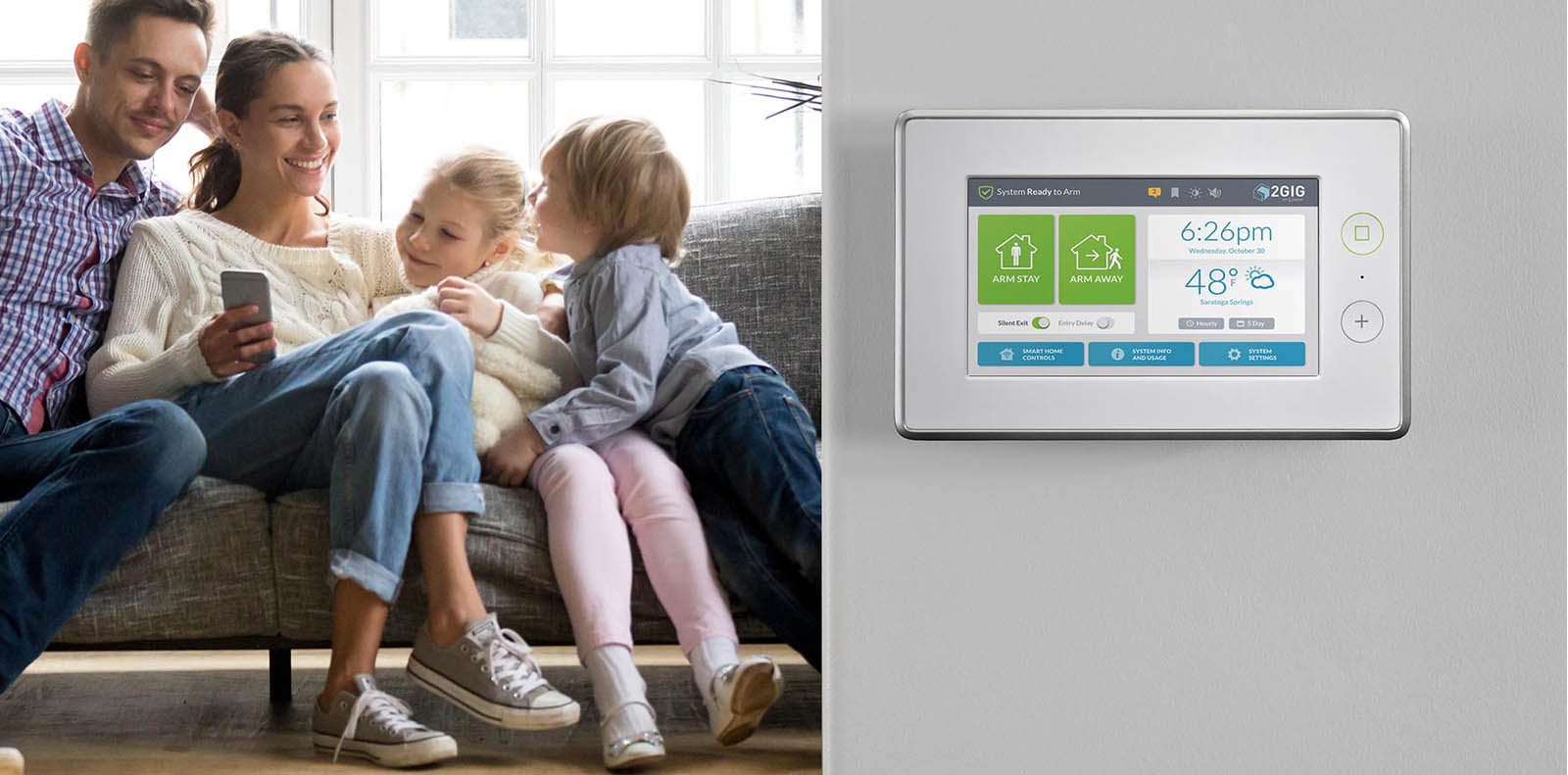 security company Chicago offering alarm security- happy family on couch controlling alarm from phone application