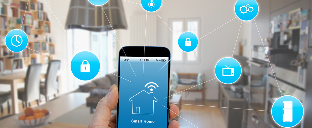 Security company Chicago offering smart home solutions- phone with application opened in clients hand connected service features for smart home including thermostat