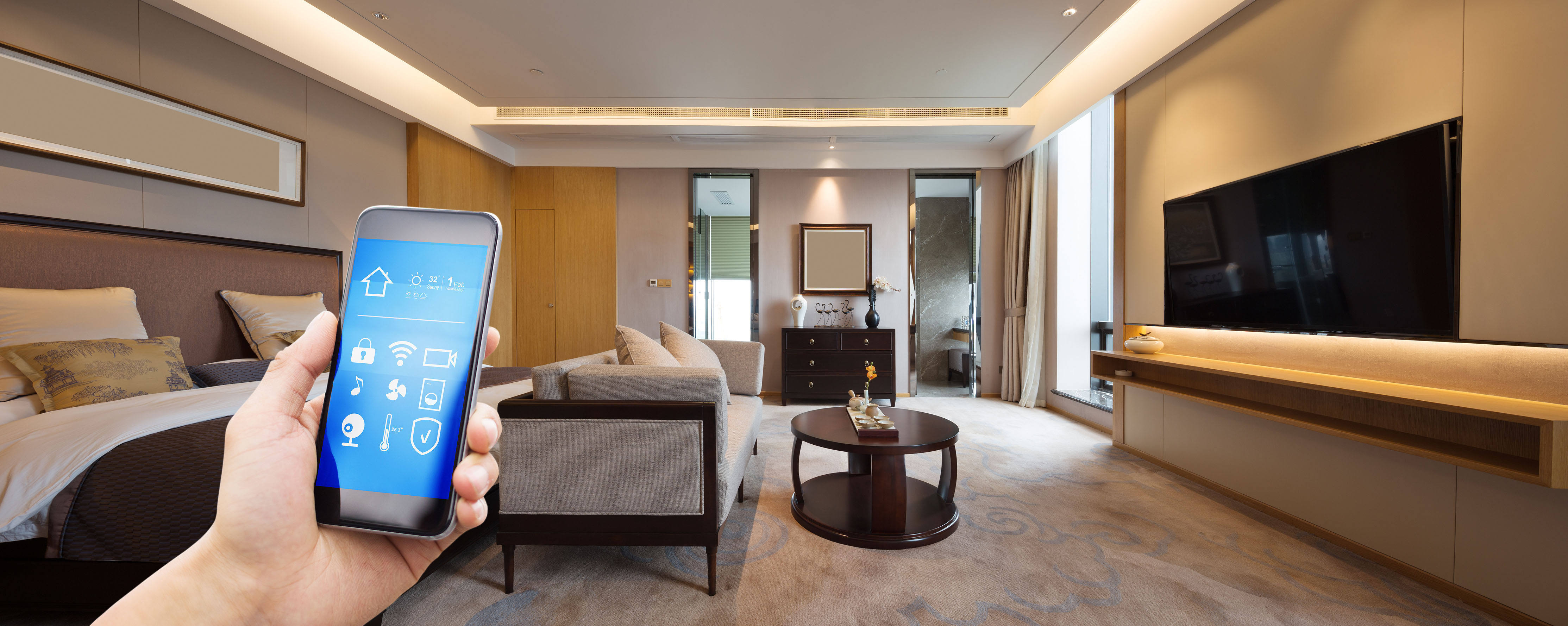 client holding phone in bedroom to control smart home features installed by smart home installation company